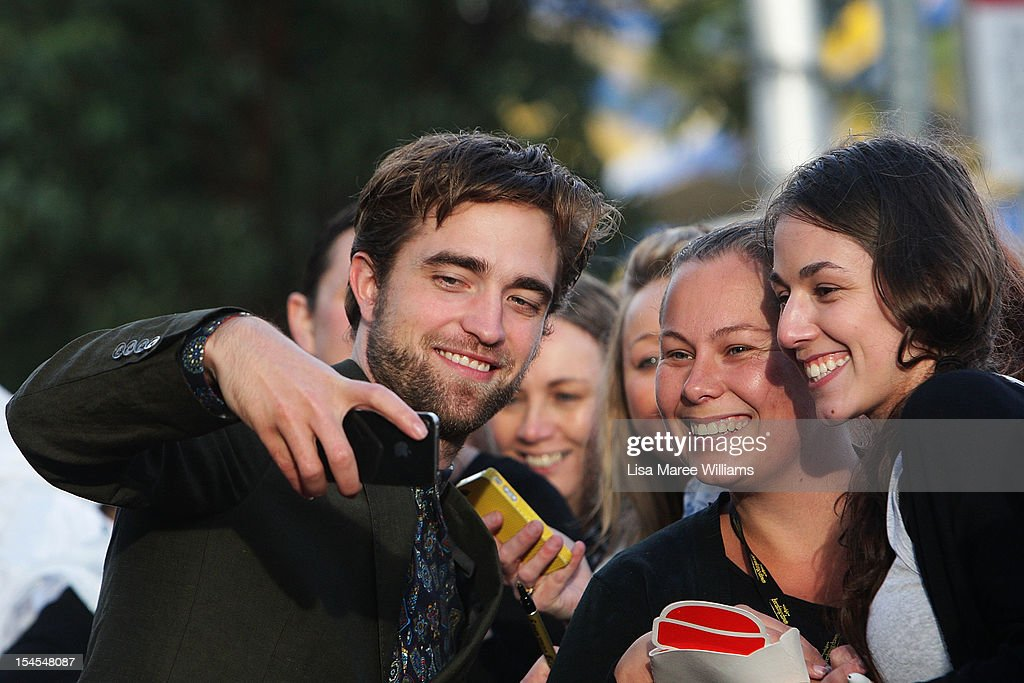 <a gi-track='captionPersonalityLinkClicked' href=/galleries/search?phrase=Robert+Pattinson&family=editorial&specificpeople=734445 ng-click='$event.stopPropagation()'>Robert Pattinson</a> greets fans during a 'Breaking Dawn - Part 2' fan event at Fox Studios on October 22, 2012 in Sydney, Australia.