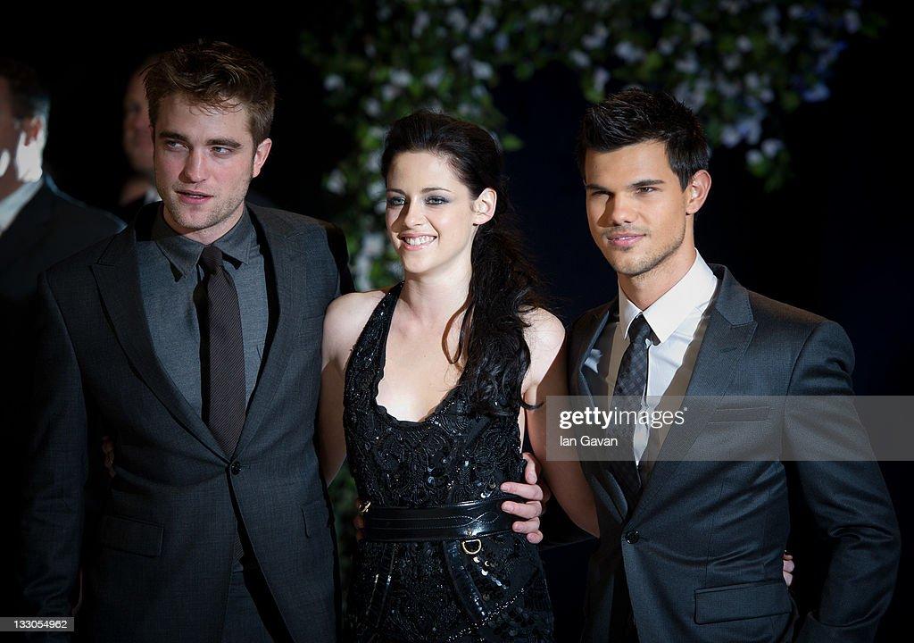 Robert Pattinson, Kristen Stewart and Taylor Lautner attend the UK premiere of The Twilight Saga: Breaking Dawn Part 1 at Westfield Stratford City on November 16, 2011 in London, England.