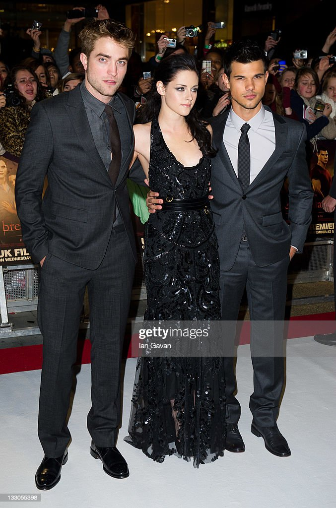 <a gi-track='captionPersonalityLinkClicked' href=/galleries/search?phrase=Robert+Pattinson&family=editorial&specificpeople=734445 ng-click='$event.stopPropagation()'>Robert Pattinson</a>, <a gi-track='captionPersonalityLinkClicked' href=/galleries/search?phrase=Kristen+Stewart&family=editorial&specificpeople=2166264 ng-click='$event.stopPropagation()'>Kristen Stewart</a> and <a gi-track='captionPersonalityLinkClicked' href=/galleries/search?phrase=Taylor+Lautner&family=editorial&specificpeople=228959 ng-click='$event.stopPropagation()'>Taylor Lautner</a> attend the UK premiere of The Twilight Saga: Breaking Dawn Part 1 at Westfield Stratford City on November 16, 2011 in London, England.
