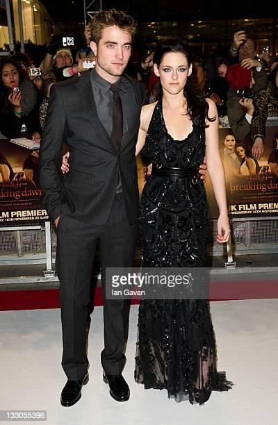 Robert Pattinson Kristen Stewart attend the UK premiere of The Twilight Saga Breaking Dawn Part 1 at Westfield Stratford City on November 16 2011 in...