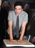 Robert Pattinson of the film 'Twilight' poses during his handprint and memorabilia donation ceremony at Planet Hollywood on November 4 2008 in New...