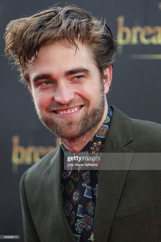 <a gi-track='captionPersonalityLinkClicked' href=/galleries/search?phrase=Robert+Pattinson&family=editorial&specificpeople=734445 ng-click='$event.stopPropagation()'>Robert Pattinson</a> poses during a 'Breaking Dawn - Part 2' fan event at Fox Studios on October 22, 2012 in Sydney, Australia.