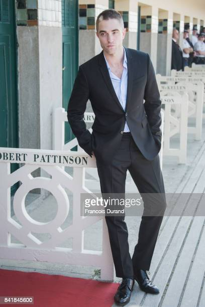 Robert Pattinson poses in front of his dedicated beach locker room on the Promenade des Planches during the 43rd Deauville American Film Festival on...