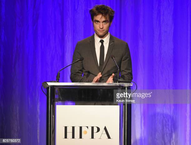 Robert Pattinson speaks onstage at the Hollywood Foreign Press Association's Grants Banquet at the Beverly Wilshire Four Seasons Hotel on August 2...