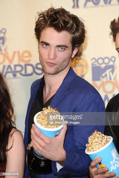 Robert Pattinson with the Best Movie Best Kiss Best Fight and Best Breakthrough Male Performance award received for Twilight at the MTV Movie Awards...