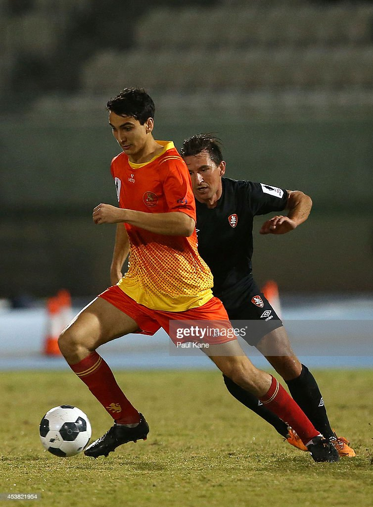 Robert Petkov of the Lions controls the ball against Shane Steffanutto of the Roar during the FFA Cup match between the Stirling Lions and the Brisbane Roar at Western Australia Athletics Stadium on August 19, 2014 in Perth, Australia.