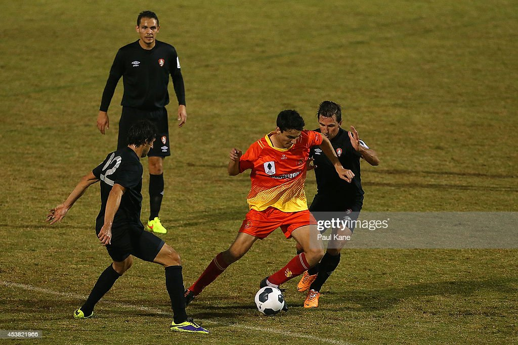 Robert Petkov of the Lions is challenged by <a gi-track='captionPersonalityLinkClicked' href=/galleries/search?phrase=Thomas+Broich&family=editorial&specificpeople=676225 ng-click='$event.stopPropagation()'>Thomas Broich</a> and Shane Steffanutto of the Roar during the FFA Cup match between the Stirling Lions and the Brisbane Roar at Western Australia Athletics Stadium on August 19, 2014 in Perth, Australia.