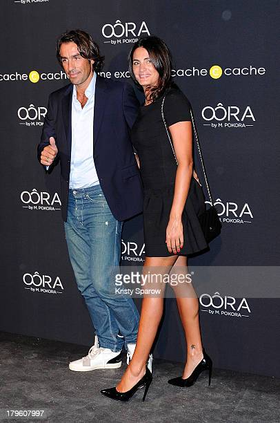 Robert Pires and Jessica Lemarie attend the photocall for 'OORA' Womenswear Collection designed by French singer Matt Pokora at Pavillon Gabriel on...