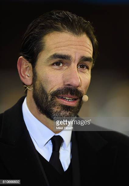 Robert Pires looks on prior to the UEFA Champions League round of 16 first leg match between Paris SaintGermain and Chelsea at Parc des Princes on...