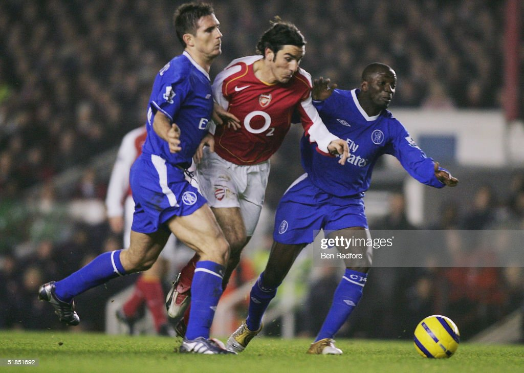 Robert Pires of Arsenal (centre) battles with Frank Lampard (left) and Claude Makelele of Chelsea before he is fouled during the Barclays Premiership match between Arsenal and Chelsea at Highbury on December 12, 2004 in London, England.