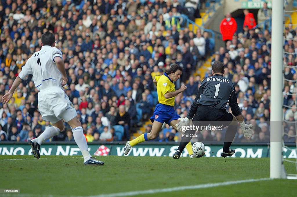 Robert Pires of Arsenal beats Paul Robinson of Leeds to score during the FA Barclaycard Premiership match between Leeds United and Arsenal at Elland...