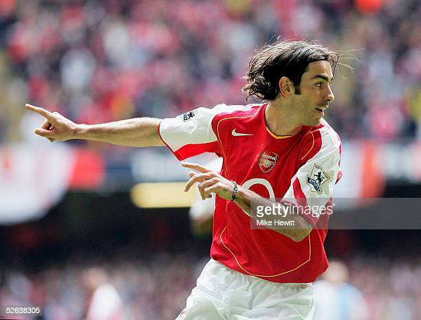 Robert Pires of Arsenal celebrates scoring the opening goal during the FA Cup SemiFinal match between Arsenal and Blackburn Rovers at the Millennium...