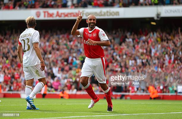 Robert Pires of Arsenal Legends celebrates after he scores a goal to make it 41 during the Arsenal Foundation Charity match between Arsenal Legends...