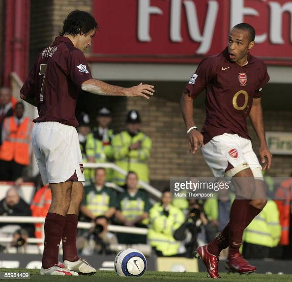Robert Pires of Arsenal looks at Thierry Henry after the confusion between them caused them to miss a penalty during the Barclays Premiership match...