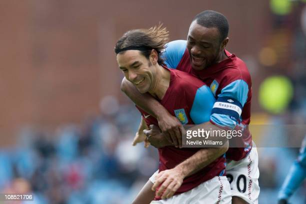 Robert Pires of Aston Villa celebrates with team mate Nigel Reo Coker during the FA Cup sponsored by EOn Fourth Round match between Aston Villa and...