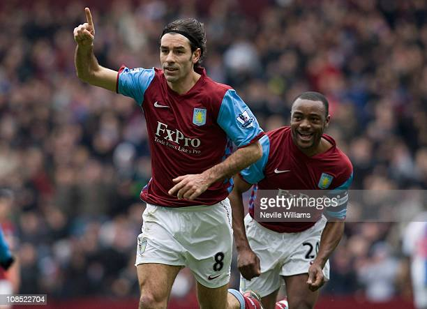 Robert Pires of Aston Villa celebrates with team mate Nigel Reo Coker during the FA Cup sponsored by EOn Fourth Round match between Blackburn Rovers...