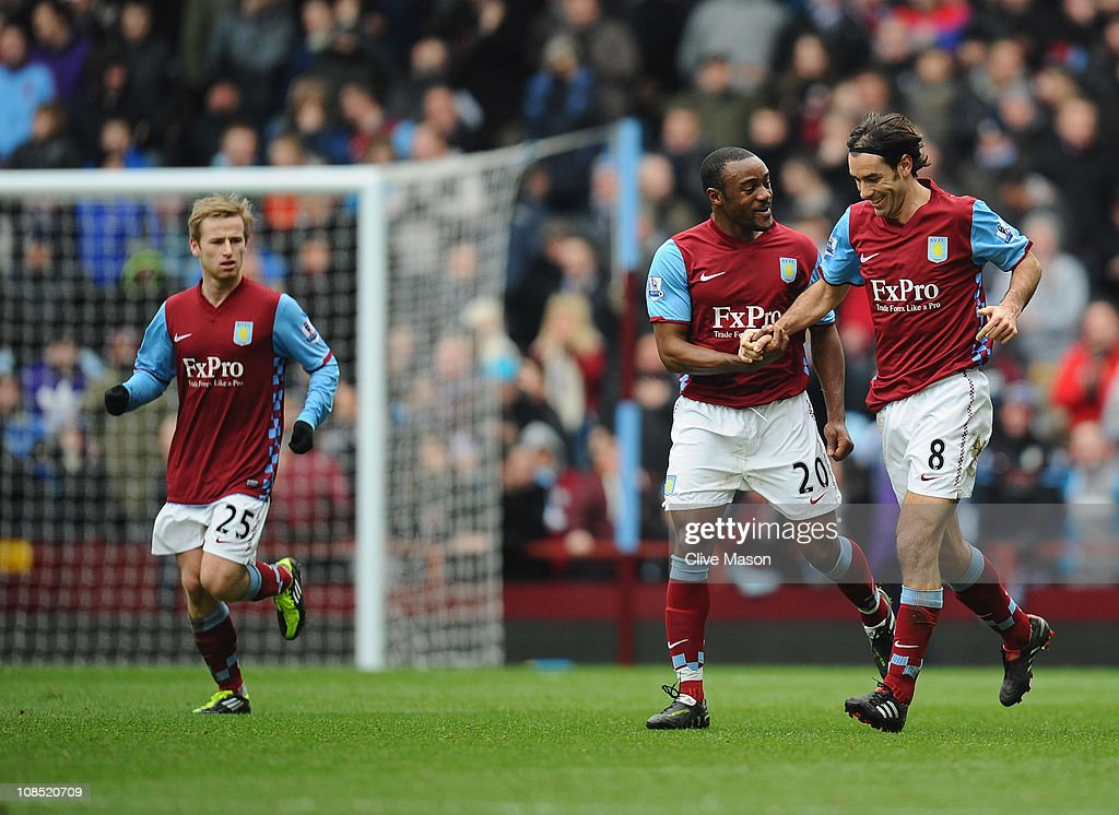 <a gi-track='captionPersonalityLinkClicked' href=/galleries/search?phrase=Robert+Pires&family=editorial&specificpeople=167225 ng-click='$event.stopPropagation()'>Robert Pires</a> of Aston Villa is congratulated on his goal by captain <a gi-track='captionPersonalityLinkClicked' href=/galleries/search?phrase=Nigel+Reo-Coker&family=editorial&specificpeople=214185 ng-click='$event.stopPropagation()'>Nigel Reo-Coker</a> of Aston Villa during the FA Cup sponsored by E.On Fourth Round match between Aston Villa and Blackburn Rovers at Villa Park on January 29, 2011 in Birmingham, England.