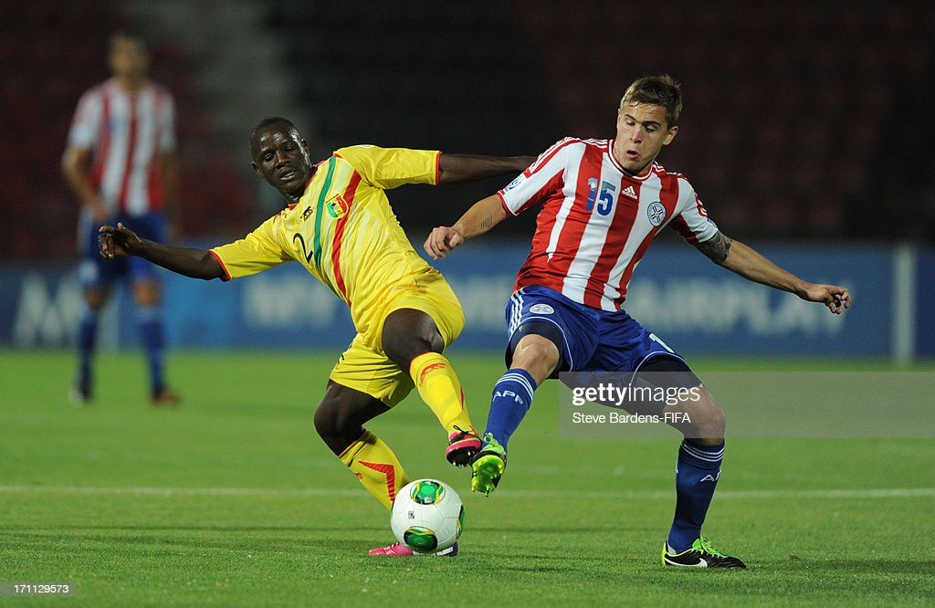 Robert Piris da Motta of Paraguay challenges for the ball with Hamidou Traore of Mali during the FIFA U20 World Cup Group D match between Paraguay and Mali at Kamil Ocak Stadium on June 22, 2013 in Gaziantep, Turkey.