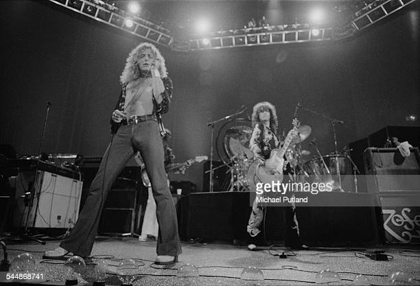 Robert Plant and Jimmy Page of British heavy rock group Led Zeppelin performing at Earl's Court London May 1975 Bassist John Paul Jones can be seen...