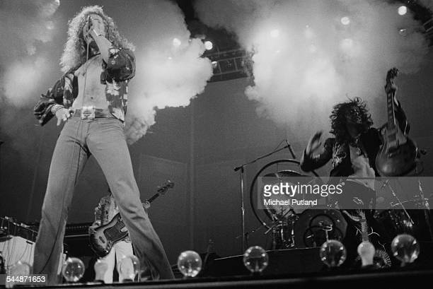 Robert Plant and Jimmy Page performing with British heavy rock group Led Zeppelin at Earl's Court London May 1975 Behind Plant is bassist John Paul...