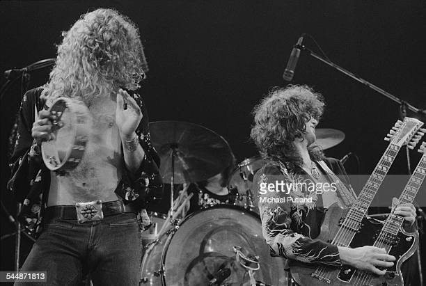 Robert Plant and Jimmy Page performing with British heavy rock group Led Zeppelin at Earl's Court London May 1975 John Bonham is behind the kit The...