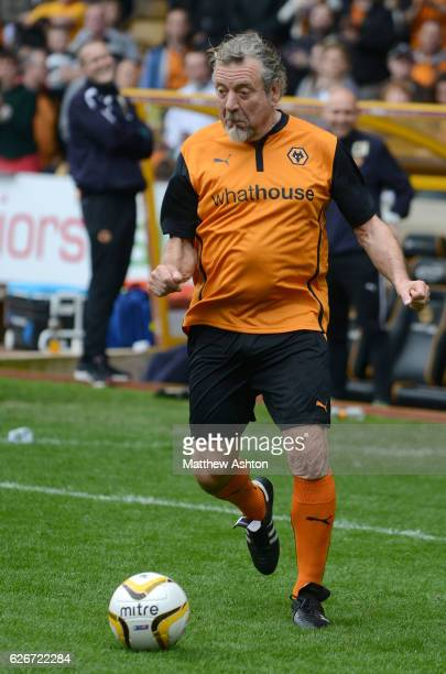 Robert Plant former singer of Led Zeppelin takes part in a penalty shoot out against Jez Moxey the CEO of Wolverhampton Wanderers at half time during...