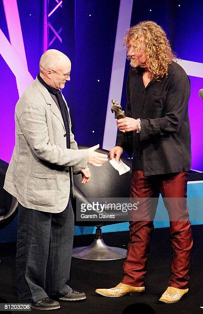 Robert Plant presents Phil Collins with the International Achievement Award at the 53rd Ivor Novello Awards at the Grosvenor House Hotel on May 22...