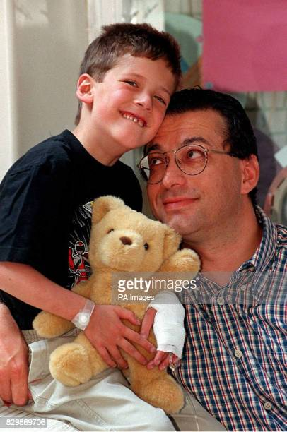 Robert Plotnek from Edgbaston Birmingham waits with his father Nick before going into theatre at Birmingham Children's Hospital for groundbreaking...