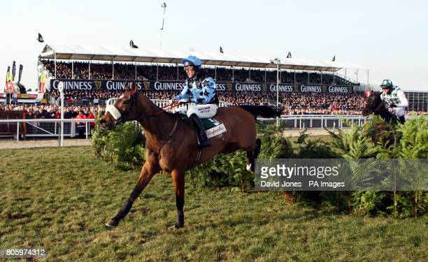 Robert Power on Silver Birch during the Glenfarclas Handicap Cross Country Steeple Chase on the first day of the Cheltenham Festival