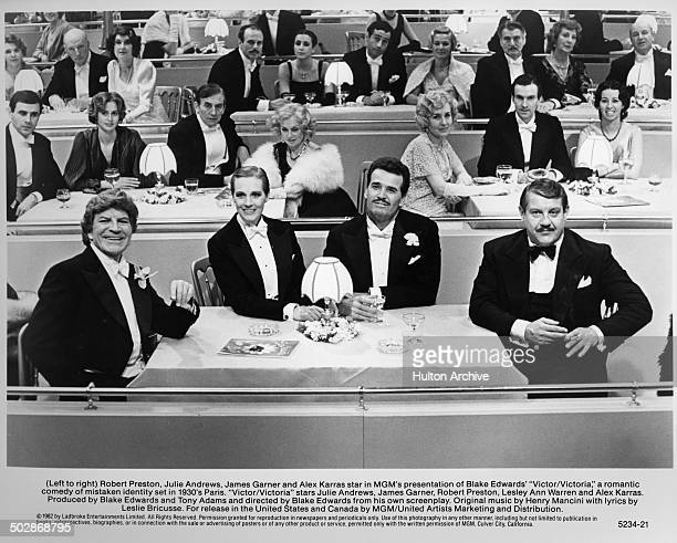 Robert PrestonJulie Andrews James Garner and Alex Karras sit at a table in a scene of the MGM movie 'Victor Victoria' circa 1982