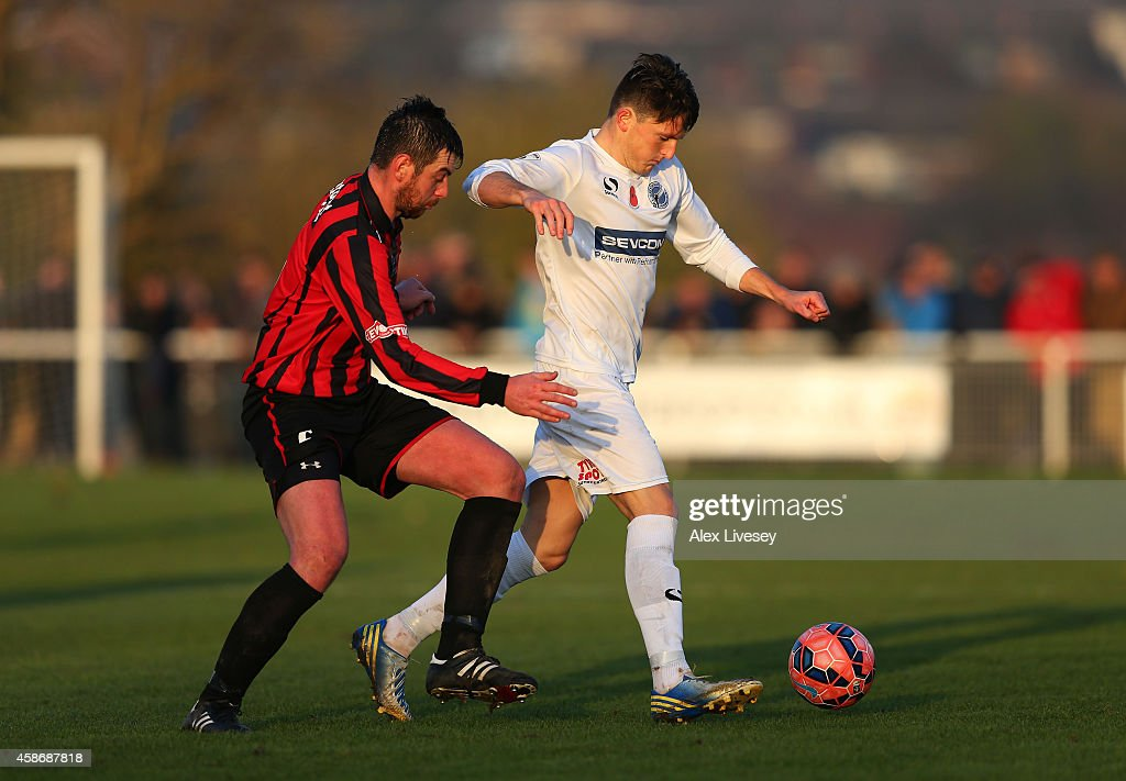 Robert Ramshaw of Gateshead is challenged by Jonathan Beaumont of Norton during the FA Cup first round match between Norton United and Gateshead at...
