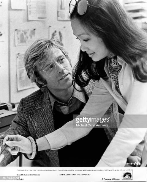 Robert Redford a CIA agent and Tina Chen discover a murder plot in a scene from the Paramount Pictures movie 'Three Days of the Condor' circa 1975