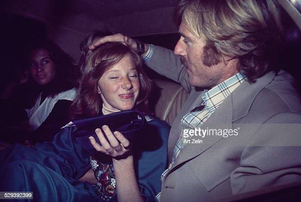 Robert Redford and his daughter Amy in taxi near Brooklyn Academy of Music he picked her up after her event circa 1970 New York