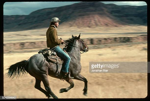 Robert Redford follows a pack of wild horses near HoleintheWall Wyoming a notorious outlaw hideout | Location Robbers Roost Outlaw Trail Utah USA