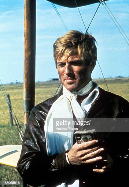 Robert Redford holds a box in a scene from the film 'The Great Waldo Pepper' 1975
