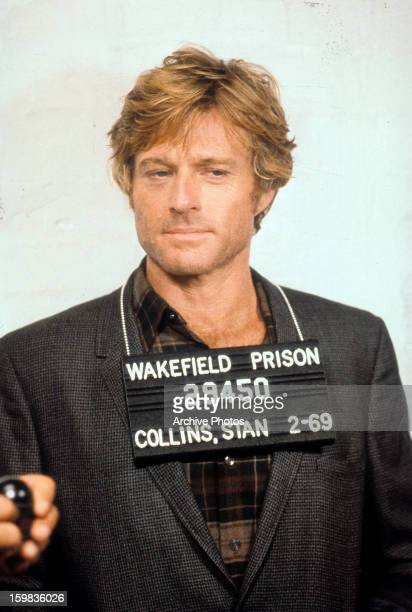 Robert Redford in a mug shot while being booked for his crime in a scene from the film 'Brubaker' 1980