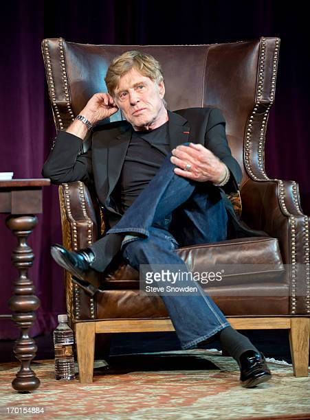 Robert Redford speaks to a full house at the Hiland Theater on historic Route 66 on June 7 2013 in Albuquerque New Mexico Redford was joined on stage...