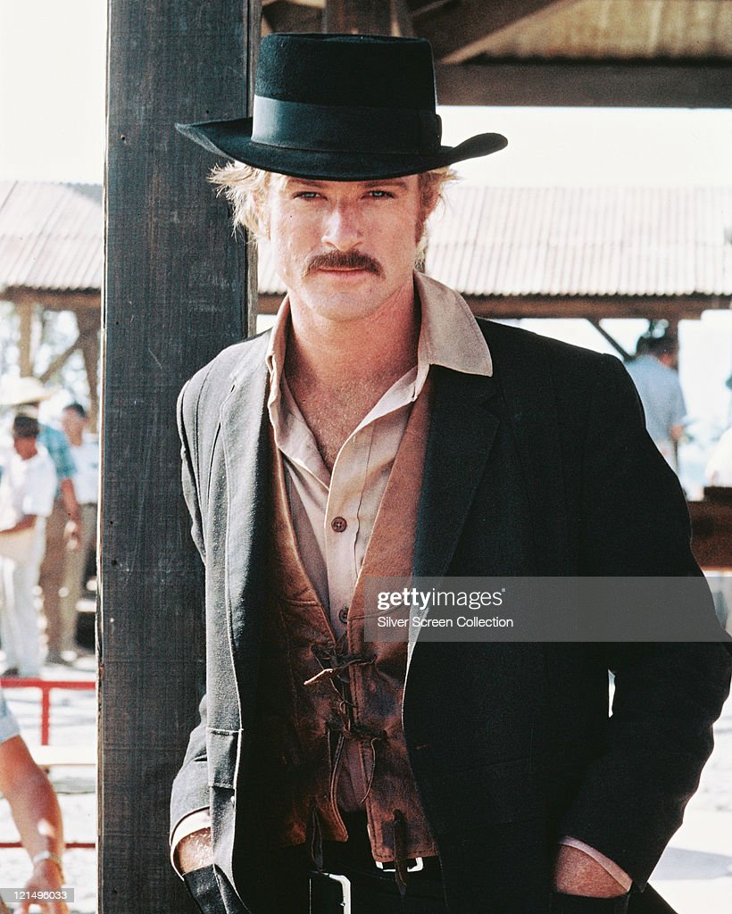 Robert Redford US actor in a Western costume with a black cowboy hat and tan leather waistcoat in a publicity portrait issued for the film 'Butch...