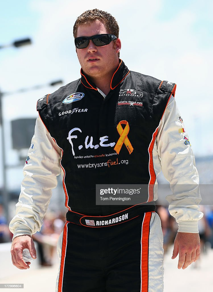 Robert Richardson Jr., driver of the #23 North Texas Pipe Chevrolet, walks on the grid during qualifying for the NASCAR Nationwide Series Subway Firecracker 250 at Daytona International Speedway on July 5, 2013 in Daytona Beach, Florida.