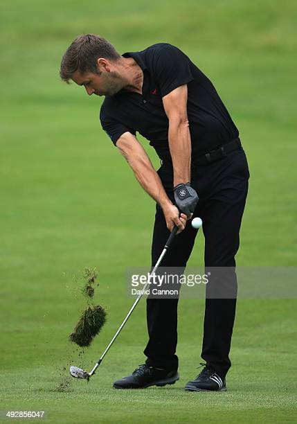 Robert Rock of England hits his 2nd shot on the 11th hole during day one of the BMW PGA Championship at Wentworth on May 22 2014 in Virginia Water...