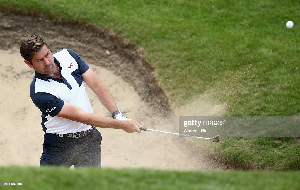 <a gi-track='captionPersonalityLinkClicked' href=/galleries/search?phrase=Robert+Rock&family=editorial&specificpeople=228315 ng-click='$event.stopPropagation()'>Robert Rock</a> of England hits his 2nd shot on the 18th hole during day one of the BMW PGA Championship at Wentworth on May 26, 2016 in Virginia Water, England.
