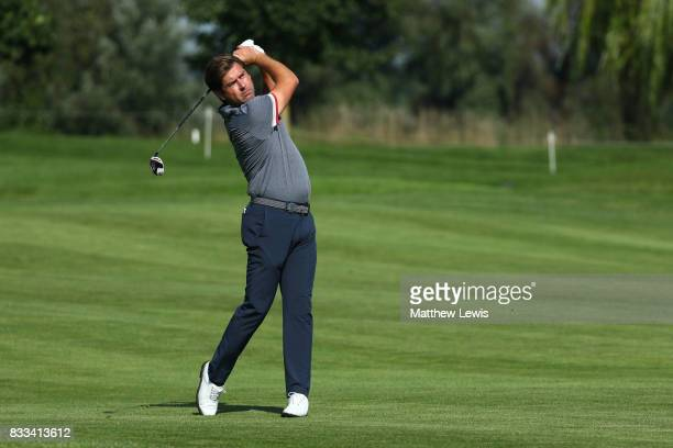 Robert Rock of England hits his second shot on the 3rd hole during round one of the Saltire Energy Paul Lawrie Matchplay at Golf Resort Bad Griesbach...