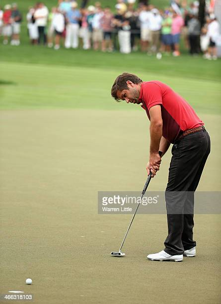 Robert Rock of England in action during the third round of the 2014 Omega Dubai Desert Classic on the Majlis Course at the Emirates Golf Club on...