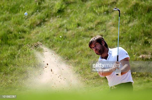 Robert Rock of England on the par five 18th hole during the first round of the Celtic Manor Wales Open on the 2010 Course at the Celtic Manor Resort...