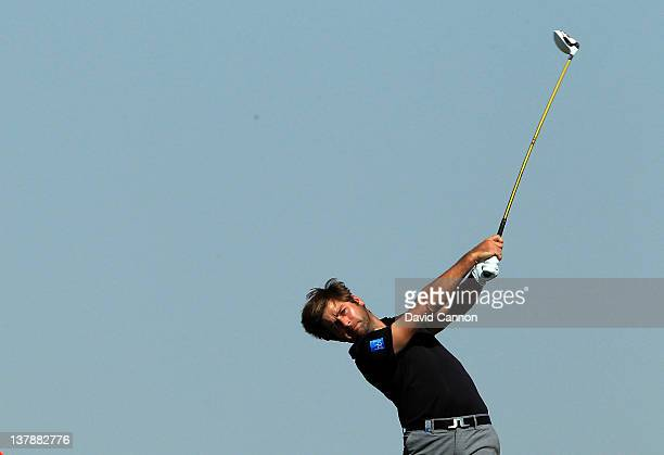 Robert Rock of England plays his tee shot on the par 4 3rd hole during the final round of the Abu Dhabi HSBC Championship at the Abu Dhabi Golf Club...
