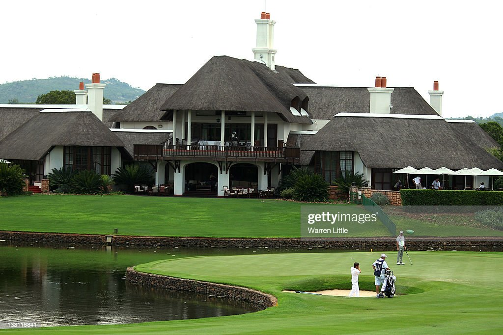<a gi-track='captionPersonalityLinkClicked' href=/galleries/search?phrase=Robert+Rock&family=editorial&specificpeople=228315 ng-click='$event.stopPropagation()'>Robert Rock</a> of England plays out of the ninth greenside bunker during the first round of the Alfred Dunhill Championships at Leopard Creek Golf Club on November 17, 2011 in Malelane, South Africa.