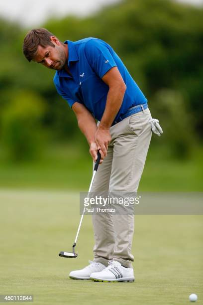 Robert Rock of England putts during the Lyoness Open day one at the Diamond Country Club on June 5 2014 in Atzenbrugg Austria