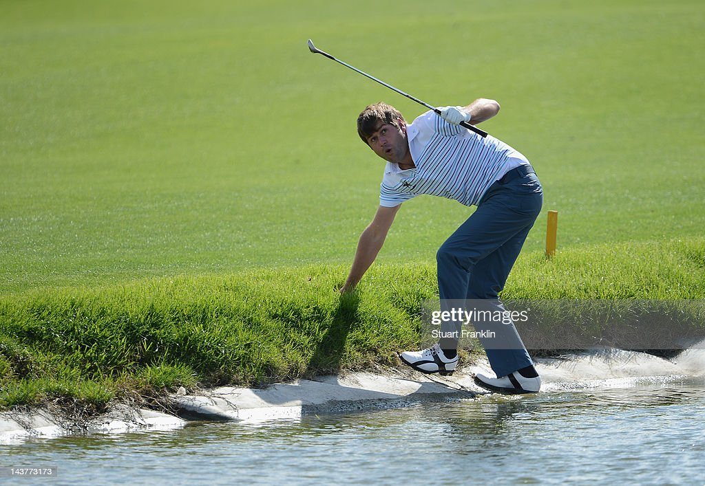 Robert Rock of England reacts after playing a shot on the 14th hole during the first round of the Open de Espana at Real Club de Golf de Sevilla on May 3, 2012 in Seville, Spain.
