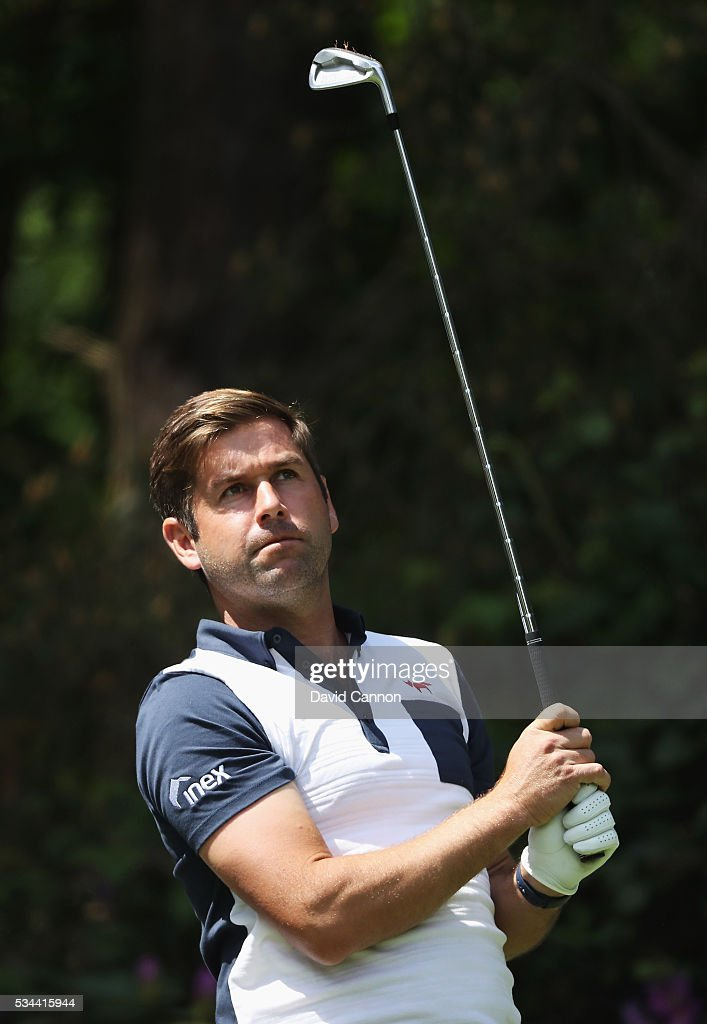 <a gi-track='captionPersonalityLinkClicked' href=/galleries/search?phrase=Robert+Rock&family=editorial&specificpeople=228315 ng-click='$event.stopPropagation()'>Robert Rock</a> of England tees off on the 10th hole during day one of the BMW PGA Championship at Wentworth on May 26, 2016 in Virginia Water, England.