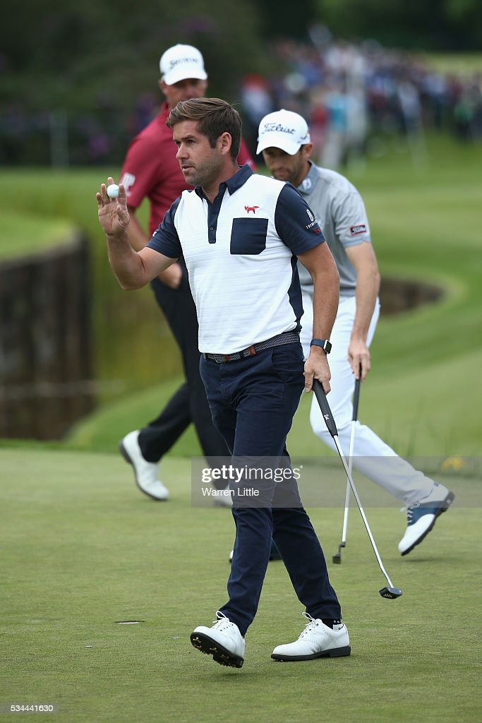 <a gi-track='captionPersonalityLinkClicked' href=/galleries/search?phrase=Robert+Rock&family=editorial&specificpeople=228315 ng-click='$event.stopPropagation()'>Robert Rock</a> of England waves on the 18th hole during day one of the BMW PGA Championship at Wentworth on May 26, 2016 in Virginia Water, England.
